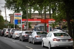 Motorists line up at an Exxon station in Charlotte, North Carolina on May 12, 2021. (Photo by LOGAN CYRUS/AFP via Getty Images)