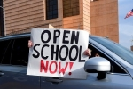 "A rally to ""Open Schools Now"" in Los Angeles on February 15, 2021. (Photo by FREDERIC J. BROWN/AFP via Getty Images)"