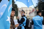 During a previous session of the U.N. Human Rights Council in Geneva, Uyghurs demonstrate outside the council against Chinese policies in Xinjiang. (Photo by Fabrice Coffrini/AFP/Getty Images)
