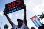 A show of support in Miami for Cubans protesting their repressive government on July 18, 2021. (Photo by EVA MARIE UZCATEGUI/AFP via Getty Images)