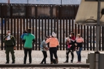 Border Patrol agents apprehend a group of migrants near downtown El Paso, Texas following the congressional border delegation visit on March 15, 2021. (Photo by JUSTIN HAMEL/AFP via Getty Images)