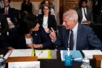 Dr. Anthony Fauci, director of the National Institute of Allergy and Infectious Diseases, speaks to Rochelle Walensky, Director of the Centers for Disease Control and Prevention, before the Senate Health, Education, Labor, and Pensions Committee hearing on July 20, 2021. (Photo by STEFANI REYNOLDS/POOL/AFP via Getty Images)